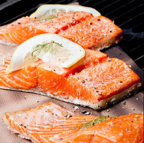 Three Grilled Salmon Filets on Cedar Plank