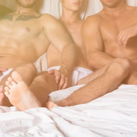 three sexy guys are resting in bed