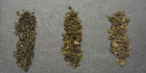 three varieties of green tea on  dark background
