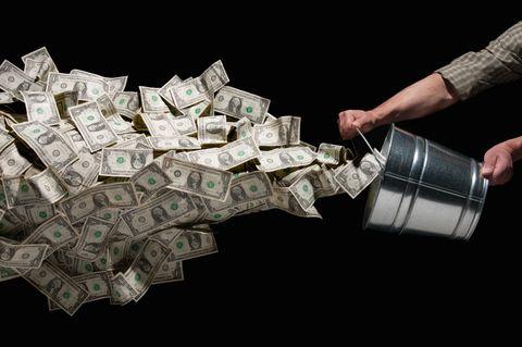 throwing bucket of money