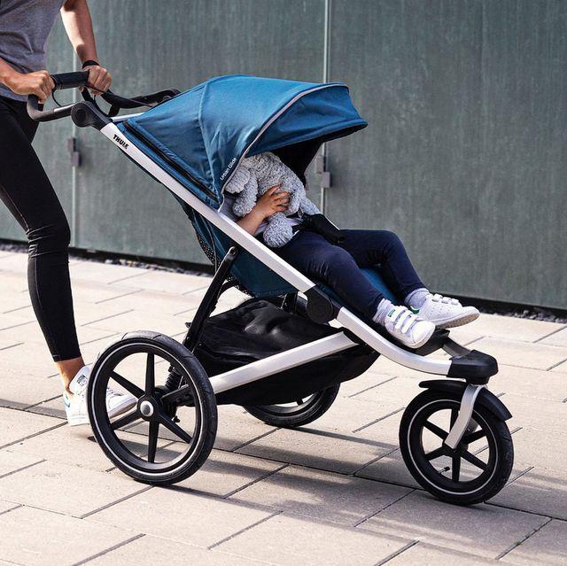 woman pushing thule urban glide jogging stroller
