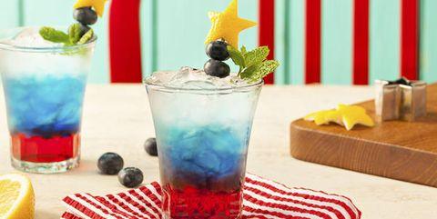 Blue, Drink, Drinkware, Alcoholic beverage, Tableware, Distilled beverage, Aqua, Cocktail, Liquid, Cocktail garnish,