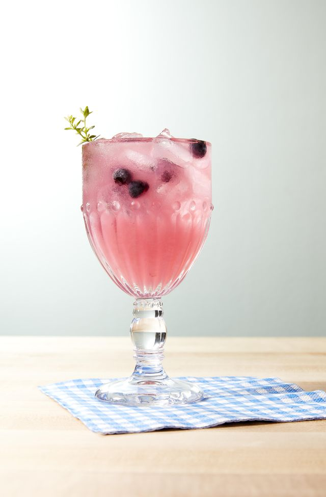 thyme blueberry lemonade with a sprig of fresh thyme