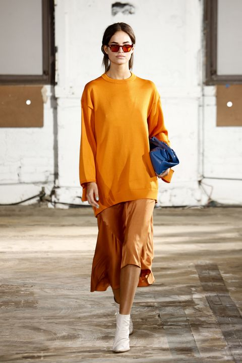 Fashion, Fashion show, Fashion model, Runway, Orange, Clothing, Yellow, Street fashion, Shoulder, Fashion design,
