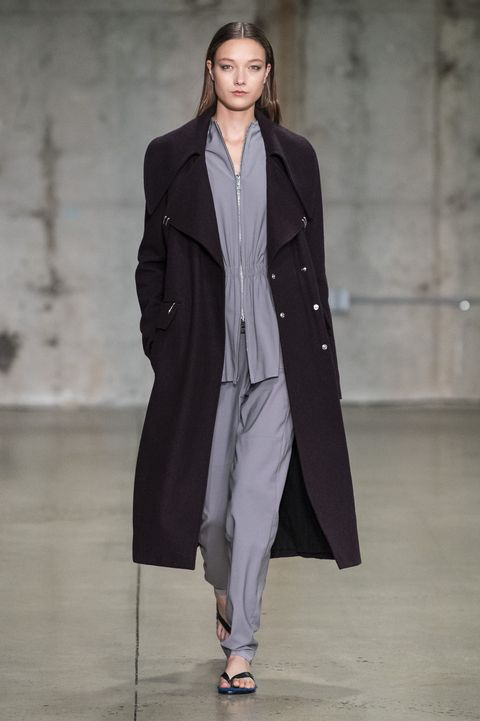 Fashion, Fashion show, Fashion model, Runway, Clothing, Overcoat, Coat, Outerwear, Public event, Human,
