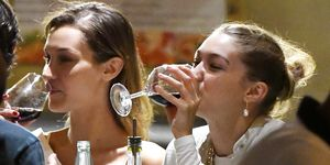 EXCLUSIVE: Bella and Gigi Hadid are Spotted at a Restaurant in Florence, Italy.