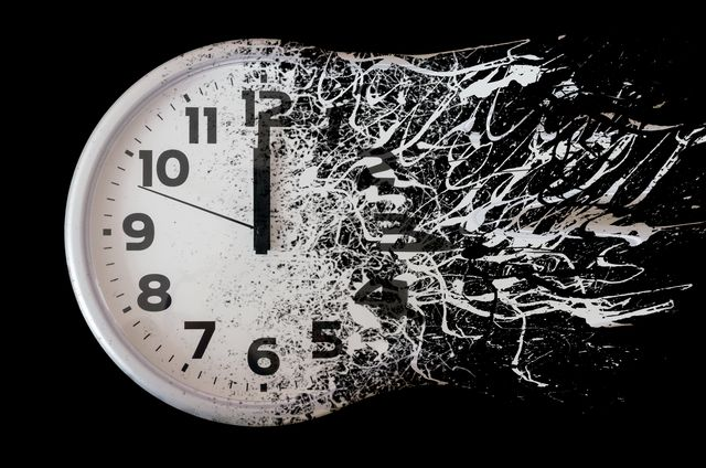 time is running out concept shows clock that is dissolving away into little particles black and white wall clock