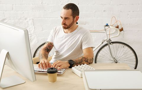 man working in office with bicycle