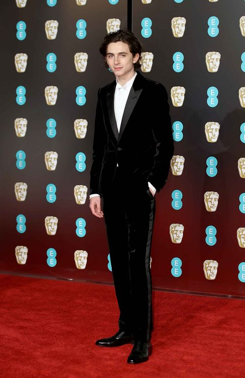 Suit, Red carpet, Carpet, Formal wear, Tuxedo, Flooring, Premiere, Electric blue,