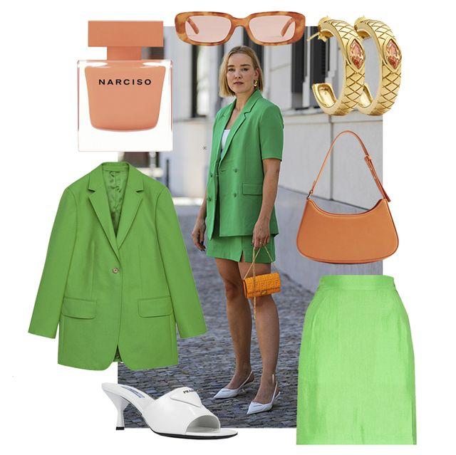 tina haase draagt groene blazer en groene mini rok met oranje details