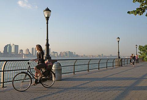 cyclist riding near river