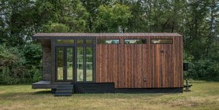 This Tiny Home Has A Greenhouse And A Porch Swing The Elsa From Olive Nest Tiny Homes