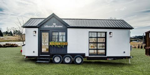 House, Property, Home, Vehicle, Travel trailer, Trailer, Building, Mobile home, Grass, Car,