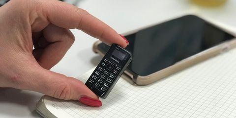Gadget, Mobile phone, Communication Device, Electronic device, Portable communications device, Technology, Finger, Smartphone, Hand, Wrist,
