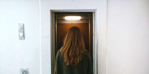 Hair, Hairstyle, Door, Long hair, Room, Brown hair, Window, Hair coloring,