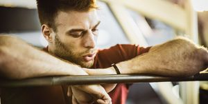 Tired male athlete taking a break in a gym.