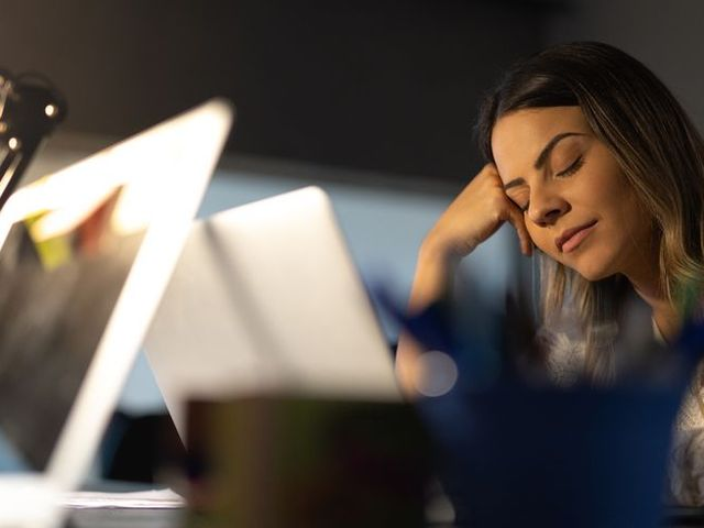 Tired woman resting at the workplace