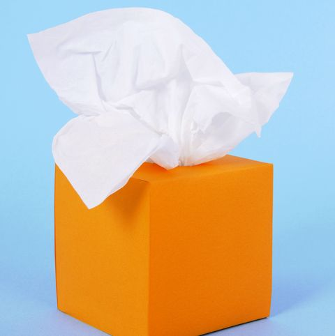 tissues in orange box on a blue background  alternative tissue box isolated on white shown below