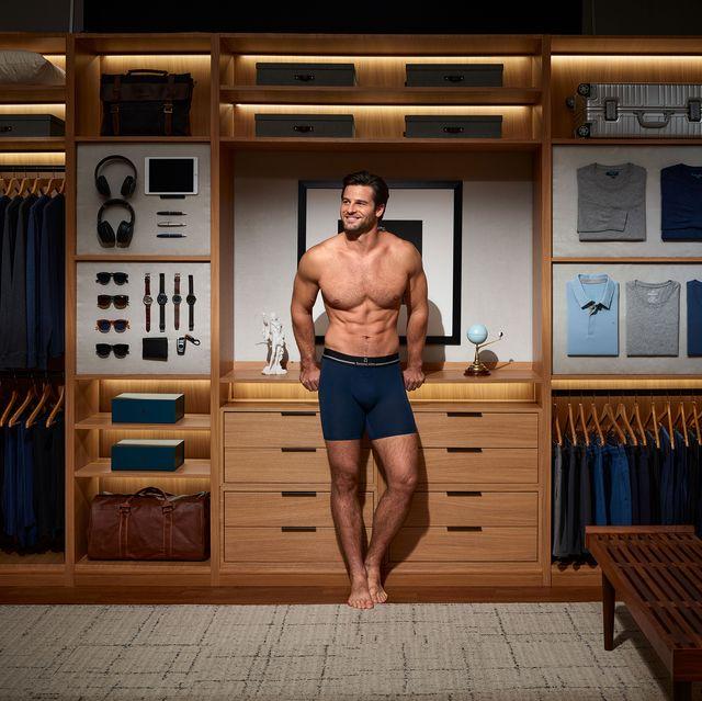 man wearing tommy john boxers standing in walk in closet