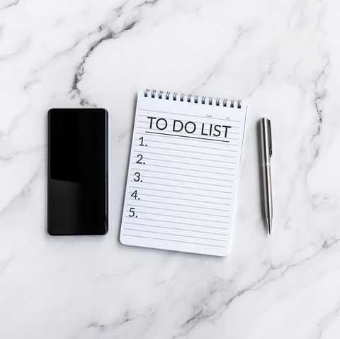 to do list text on note pad with smart phone and pen