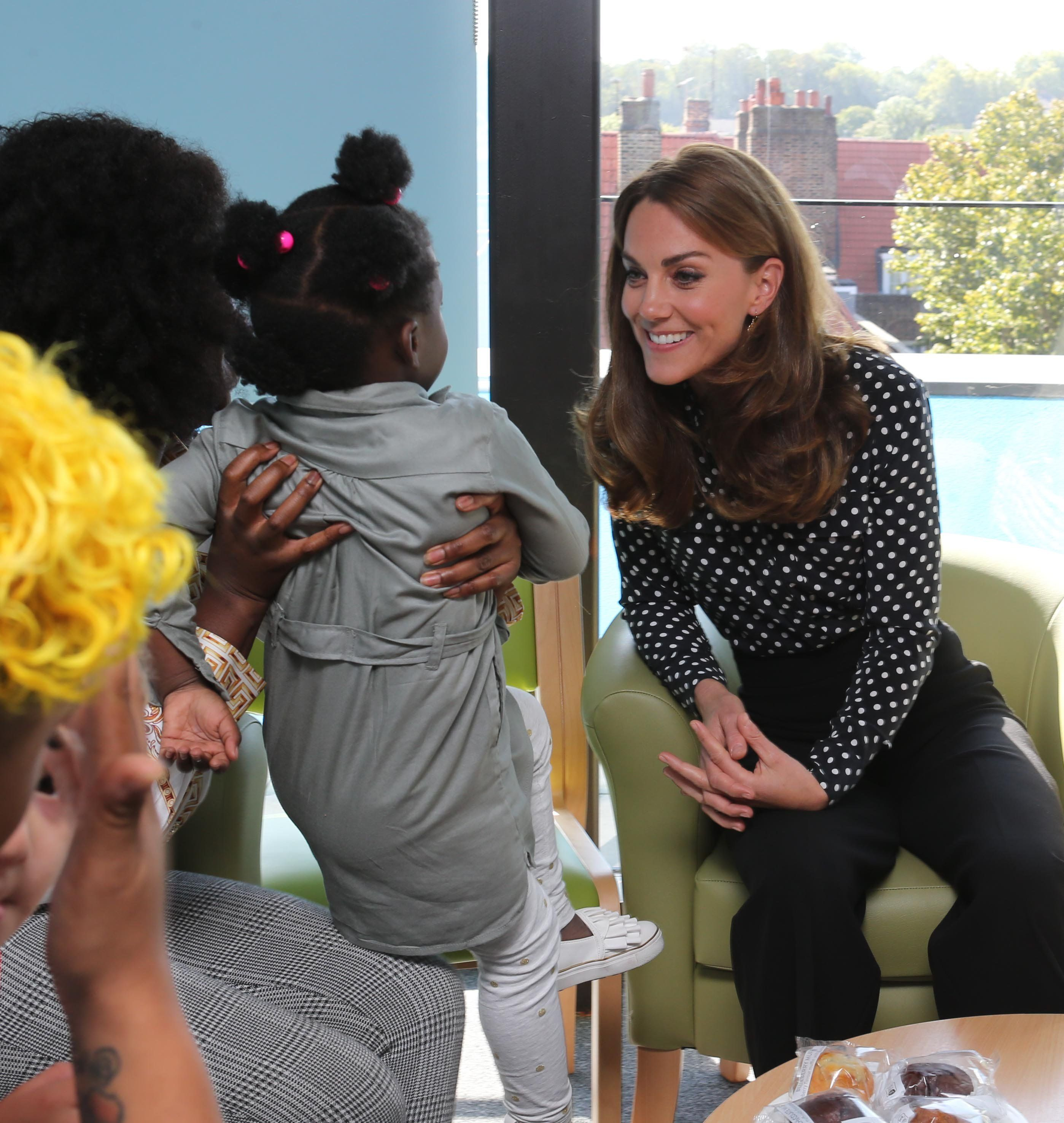 Kate Middleton Wears a Polka Dot Blouse and Wide-Leg Trousers for a Surprise Appearance