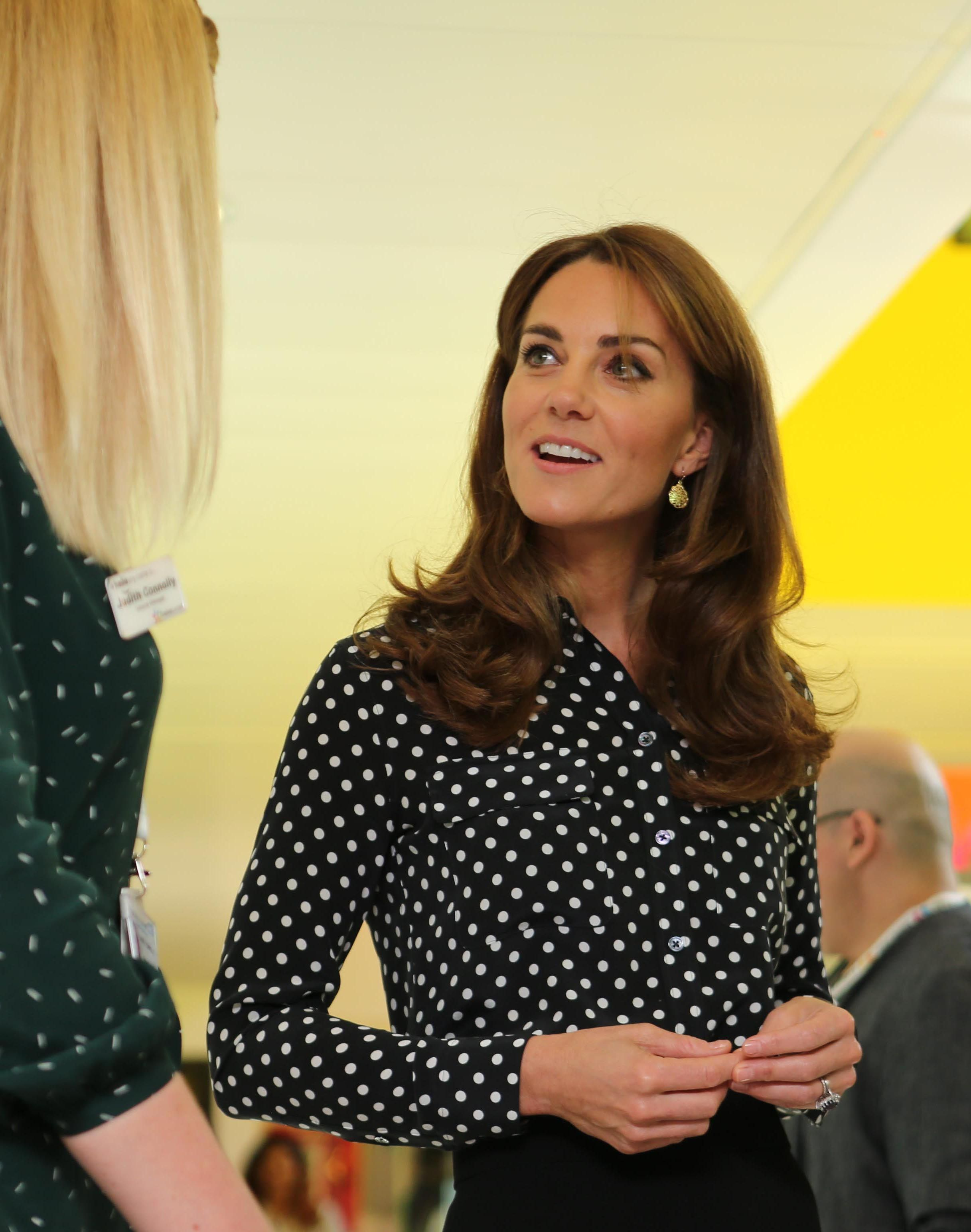 The Duchess of Cambridge steps out in a chic polka dot shirt for surprise engagement