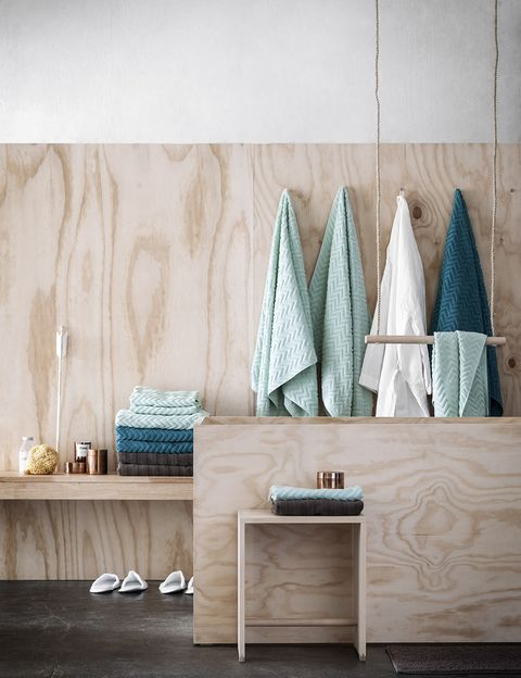 Turquoise, Room, Furniture, Wall, Table, Shelf, Tile, Interior design, Wood, Floor,