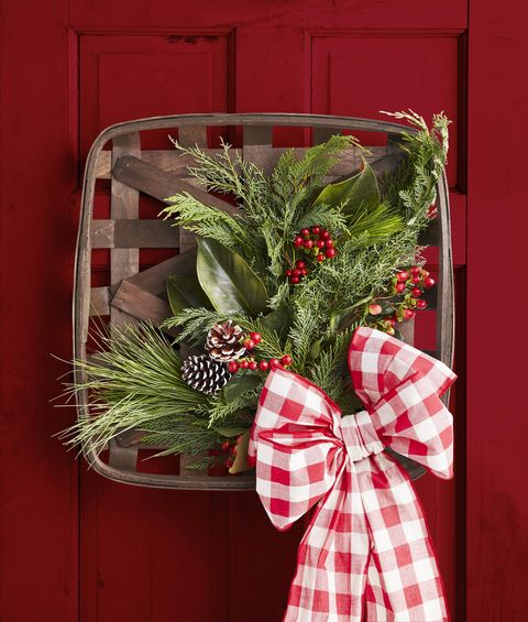 tobacco basket wreath with greenery, pine cones, and oversized bow