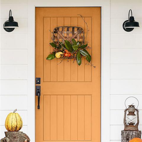 fall doorway, autumn decor orange door, dog lying in the yard
