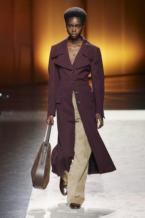Fashion model, Fashion, Fashion show, Runway, Clothing, Suit, Brown, Outerwear, Human, Pantsuit,