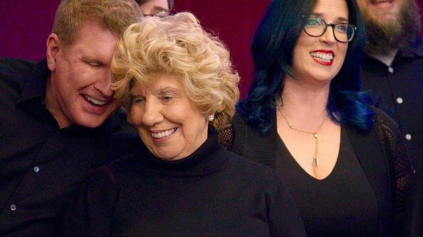 todd and his mother faye chrisley sing in an cappella group
