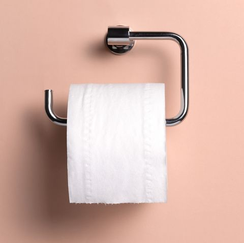 toilet paper roll on pink wall
