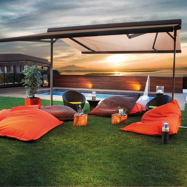 Sky, Grass, Orange, Shade, Canopy, Atmosphere, Leisure, Tent, Lawn, Furniture,