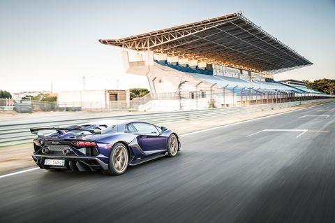 Land vehicle, Vehicle, Car, Supercar, Automotive design, Sports car, Performance car, Lamborghini, Rim, Race track,