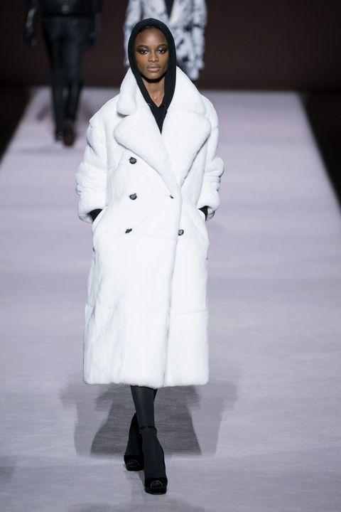 Fashion, Fashion model, White, Clothing, Runway, Fashion show, Coat, Outerwear, Overcoat, Human,
