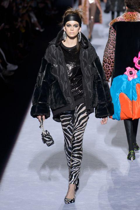 Fashion model, Fashion, Fashion show, Runway, Clothing, Leggings, Outerwear, Human, Street fashion, Footwear,