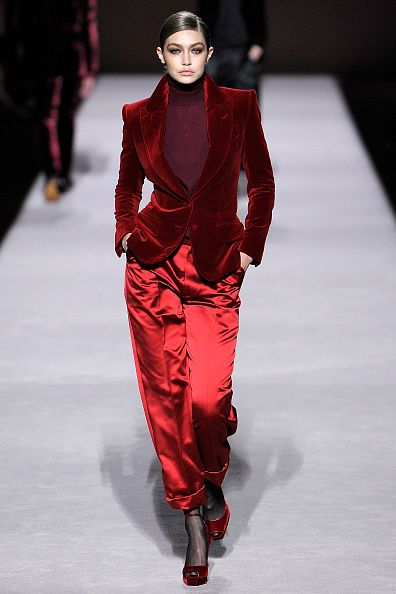 Fashion model, Fashion show, Runway, Fashion, Clothing, Red, Suit, Fashion design, Human, Public event,