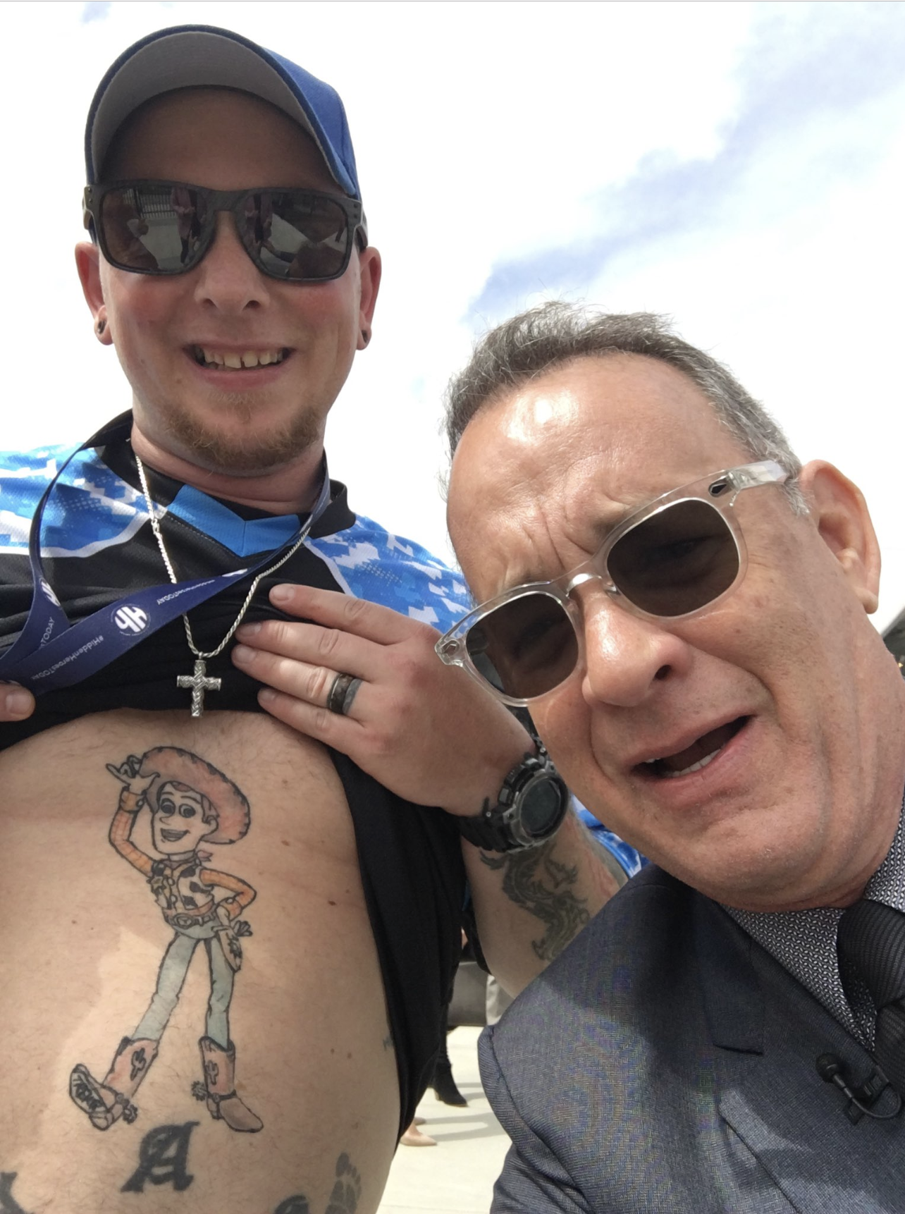 Tom Hanks Found a Guy With Woody From Toy Story Tattooed on His Belly and Quite Frankly We Have Questions