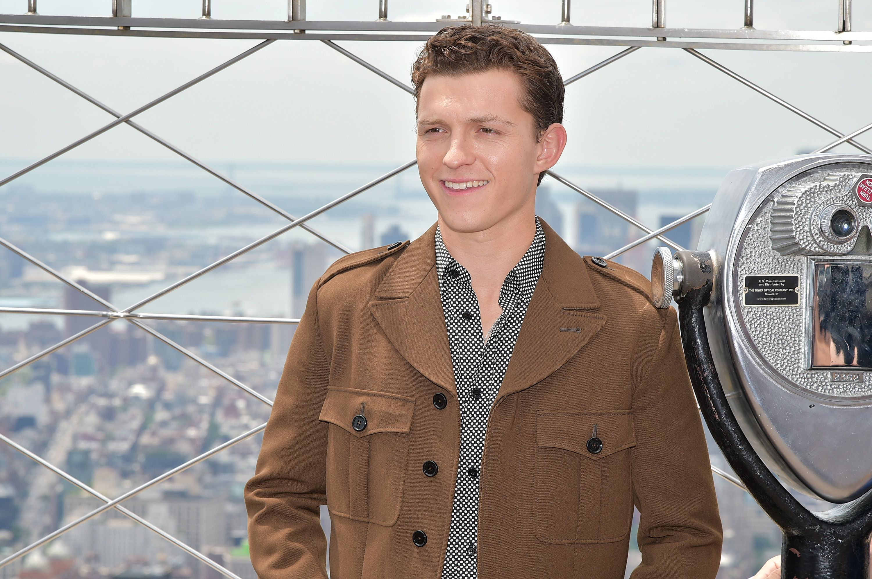 Tom Holland Saved a Fan From Getting Crushed by Crazy Autograph Seekers