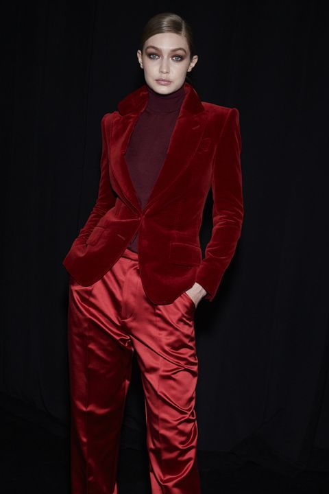 Clothing, Fashion model, Red, Suit, Fashion, Formal wear, Velvet, Outerwear, Model, Haute couture,