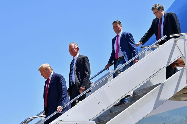 us president donald trump steps off air force one, alongside us attorney general william barr r, ronny jackson 2nd r, candidate for united states representative for texas's 13thcongressional district, and tommy tuberville 2nd lcandidate for united states senate from alabama, upon arrival in dallas, texas, on june 11, 2020, where he will host a roundtable with faith leaders and small business owners photo by nicholas kamm  afp photo by nicholas kammafp via getty images