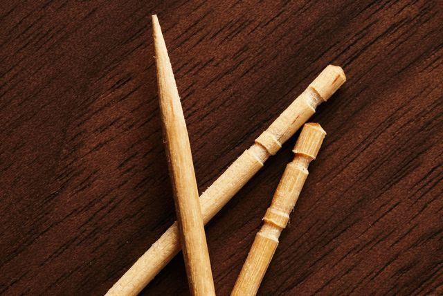 three toothpicks on wooden table