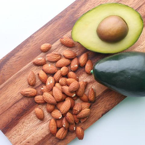 top view of almond and avocado on chopping board