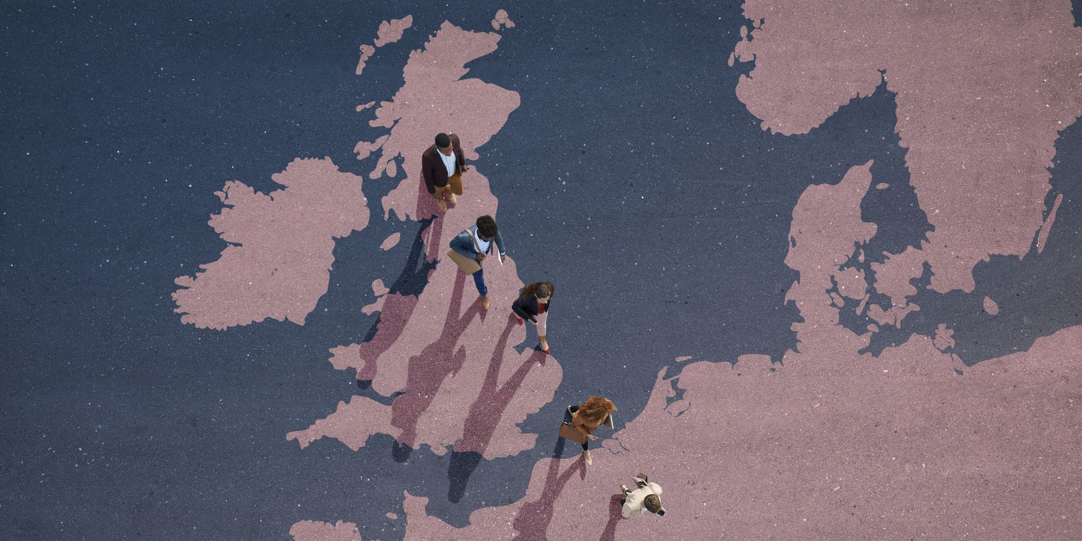Top view of businesspeople walking out of Great Britain on painted north european map