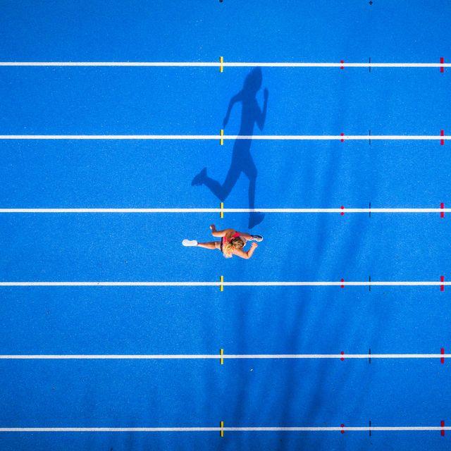 top view of female runner on tartan track
