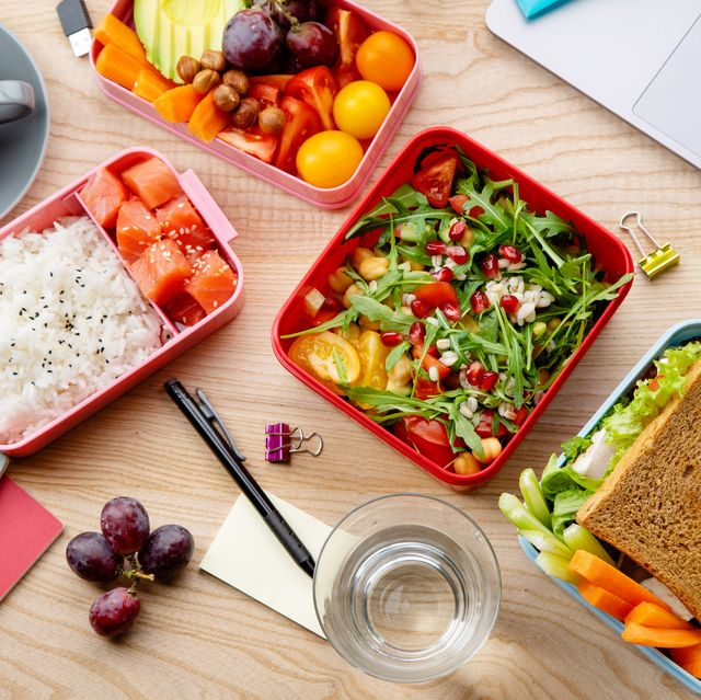 top view shot with healthy lunch dishes variety salad with grains, salmon and rice, sandwich and fruit snacks daily office or school lunch concept