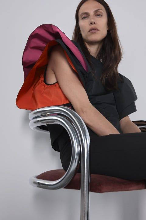 Sitting, Leg, Beauty, Furniture, Long hair, Material property, Thigh, Bar stool, Human leg, Chair,