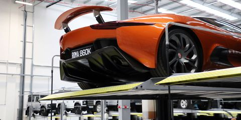 Automotive design, Automotive exterior, Rim, Fender, Orange, Automotive lighting, Alloy wheel, Concept car, Bumper, Supercar,