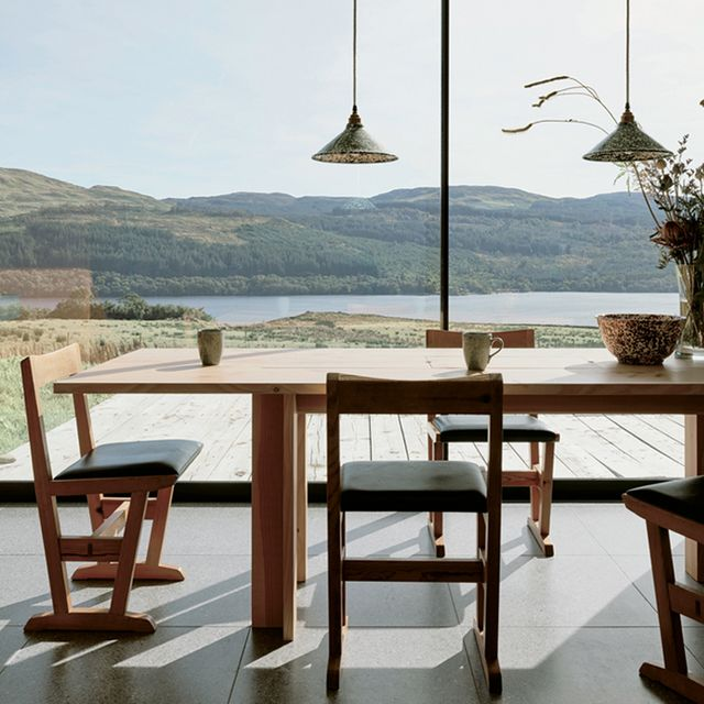 Table, Highland, Furniture, House, Real estate, Hill, Outdoor table, Mountain range, Hardwood, Roof,