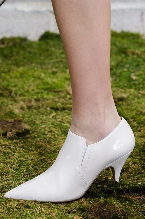 cf847ab67256 Imaxtree. White hot patent leather boots with kitten heels walked down the  runway at Tory Burch.